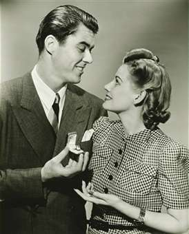 image showing a man presenting a diamond engagement ring to a woman