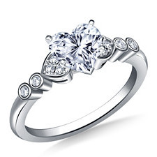 Heart shaped diamond engagement ring with side stones