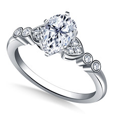 Pear shaped diamond engagement ring with heart shaped side stone setting