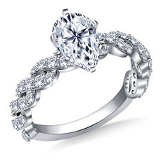 Pear shaped diamond engagement ring with twisted shank pave setting