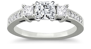 Radiant cut diamond engagement ring with 3 stone pave setting