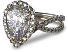 Pear shaped diamond engagement ring with split shank pave halo setting
