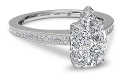 Pear shaped engagement ring with pave channel set band