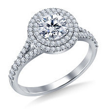 Round brilliant diamond engagement ring with halo setting