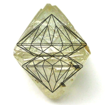 Diagram showing two ideal cut diamonds from a rough diamond