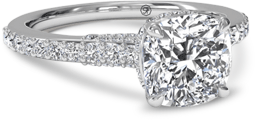 Cushion cut engagement ring with pave setting