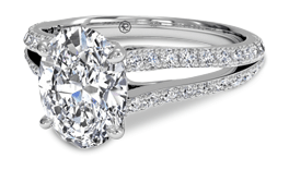 Oval diamond engagement ring with split shank pave setting