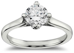 East west solitaire engagement ring