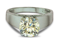 Diamond engagement ring showing white colored setting and warm colored diamond