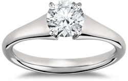 round brilliant solitaire engagement ring with flared setting