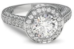 Pave halo engagement ring in palladium