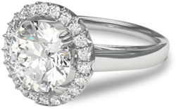Halo cathedral diamond engagement ring in palladium setting