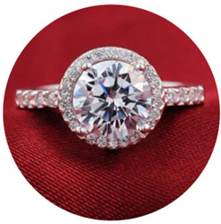 Halo round brilliant engagement ring