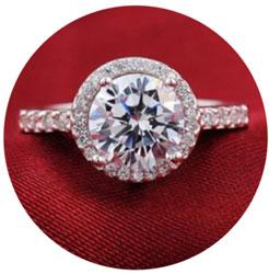 Halo round brilliant engagement ring