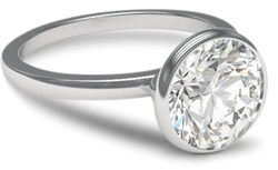 Bezel engagement ring with platinum setting