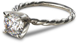 solitaire engagement ring with twisted cable band
