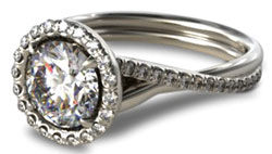 halo engagement ring with twisted pave shank