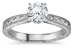 White gold and engraved millgrain diamond solitaire engagement ring