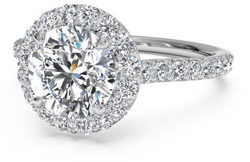 Diamond engagement ring with halo setting and pave band