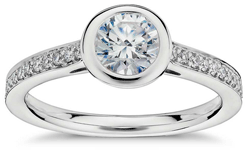 Bezel set engagement ring with Pave band