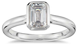Emerald cut diamond bezel engagement ring