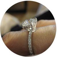pave ring on finger e1428997297165 - Pavé engagement rings