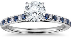 solitaire engagement ring with diamond and sapphire pave setting
