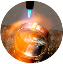 oxy acetylene torch heating a platinum ring