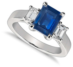 Emerald cut sapphire engagement ring with diamond side stones