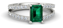 emerald engagement ring with split shank pave band