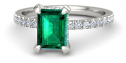 Emerald engagement ring with pave setting