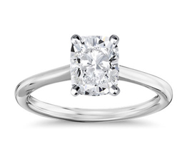 Petit solitaire cushion cut diamond engagement ring