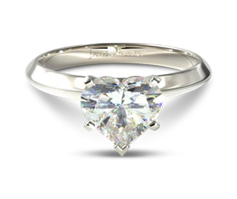 Knife edge five prong heart solitaire diamond ring