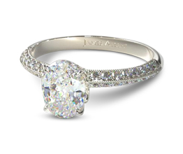 Knife edge pavé oval diamond engagement ring