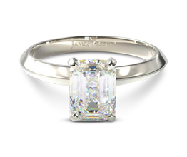 Knife edge solitaire emerald engagement ring