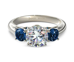 Three stone diamond ring with sapphire side stones