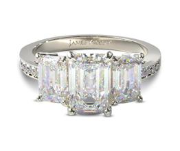 Three stone emerald and pavé diamond engagement ring