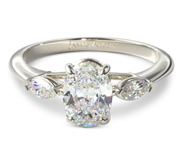 Three stone oval diamond ring with marquise side stones