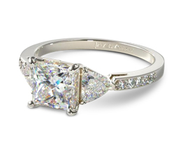 Three stone princess cut engagement ring with trillion side stones