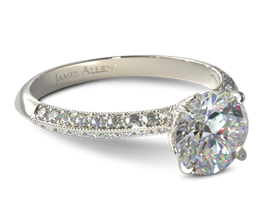Knife edge two row pavé round diamond engagement ring
