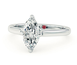 Four claw solitaire marquise diamond engagement ring