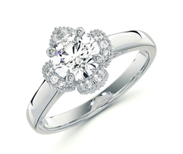 Baroque vintage feel diamond halo engagement ring